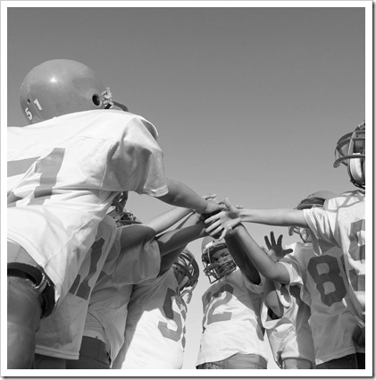 Team Huddle Before the Game --- Image by © Royalty-Free/Corbis